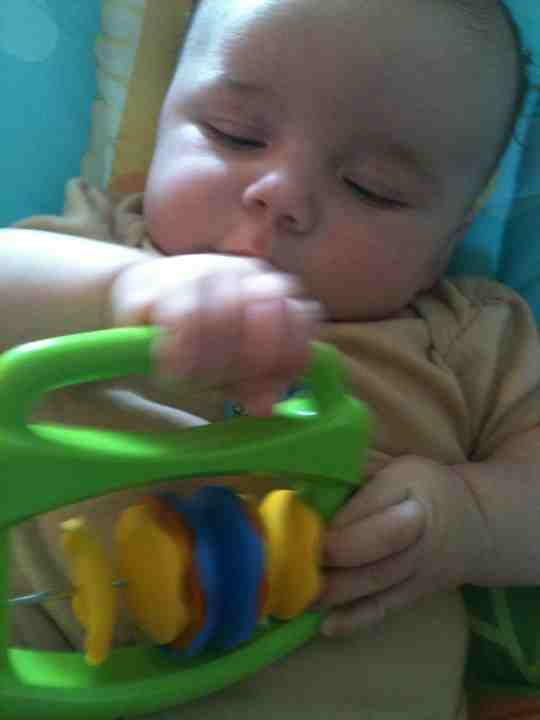 baby with shaker instrument